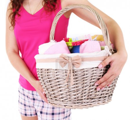 Woman holding laundry basket