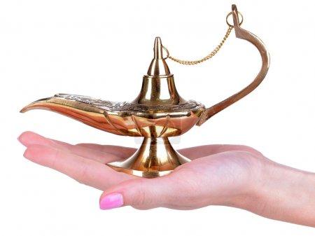 Photo pour Lampe magique dans les mains féminines isolées sur blanc - image libre de droit