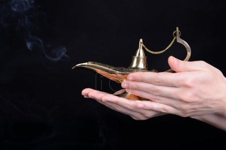 Magic lamp in hands