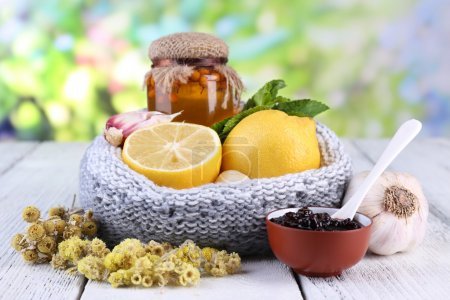 Photo for Folk remedies for colds on table on natural background - Royalty Free Image