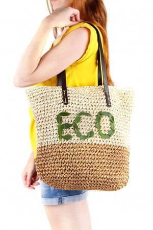 Photo for Woman with summer wicker Eco bag, on grey wall background - Royalty Free Image
