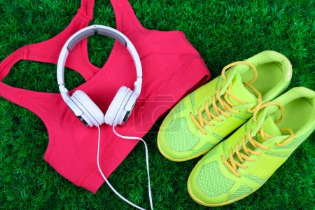 Sport clothes with shoes and headphones