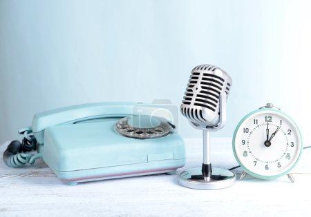 Vintage microphone,phone and alarm clock