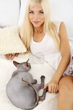 Woman with gray sphinx cat