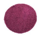 Fialový koberec na bílém pozadí