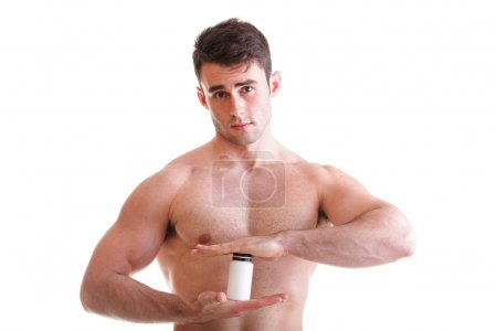 Sexy male body builder holding a boxes with supplements
