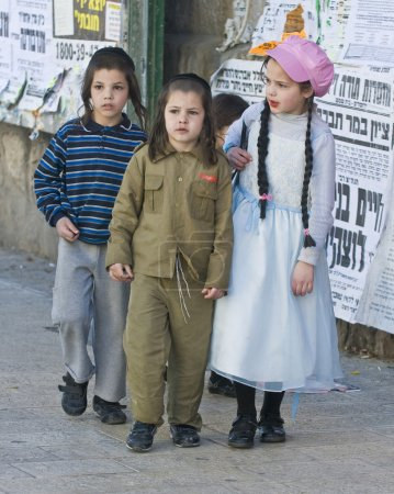 JERUSALEM - MARS 09 : Ultra Orthodox costumed chil...