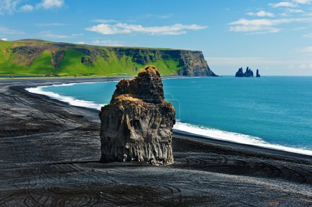 Beautiful rock formation on a black volcanic beach...