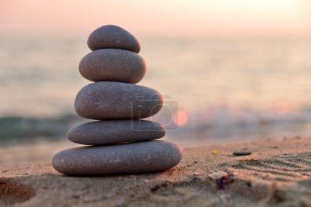 Zen stones at sunset