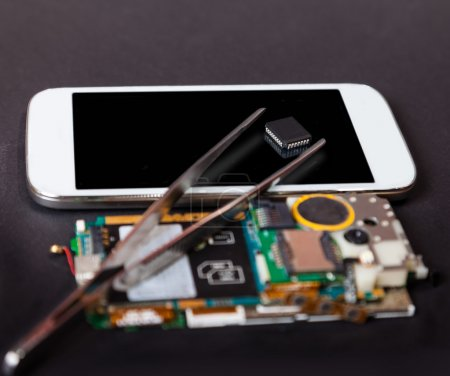 Photo for Repair of mobile devices, electronics background - Royalty Free Image
