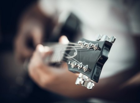 guitar in the hands of the young man