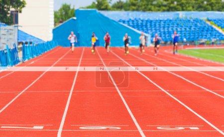 Photo for Athletes race men,sports background - Royalty Free Image