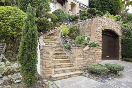 Stone Veneer Faccade on Home Exterior with Manicur...