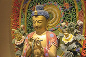 Dřevěné vyřezávané, sedící buddha closeup