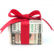 Dollar wrapped gift box with a red ribbon bow...