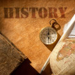 History etched on an old paper scroll with a feath...
