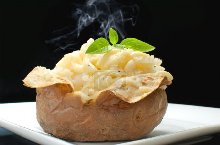 Photo for Hot oven cooked jacket potato - Royalty Free Image