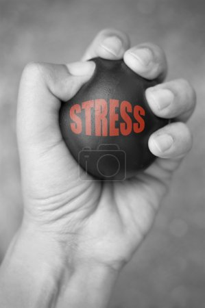 Photo for Hand squeezing a stress ball - Royalty Free Image