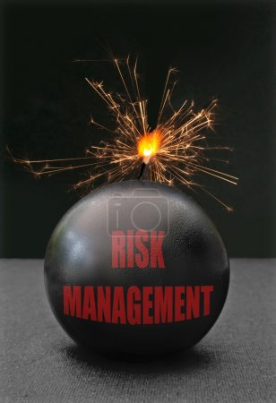 Photo for Exploding bomb labeled risk management with burning fuse - Royalty Free Image