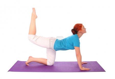 Yong woman exercise yoga pose on mat