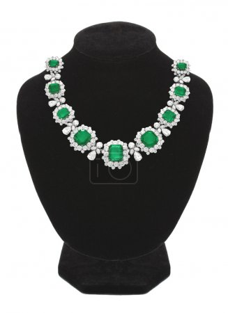 Pendant with green gem stones on black mannequin isolated on whi