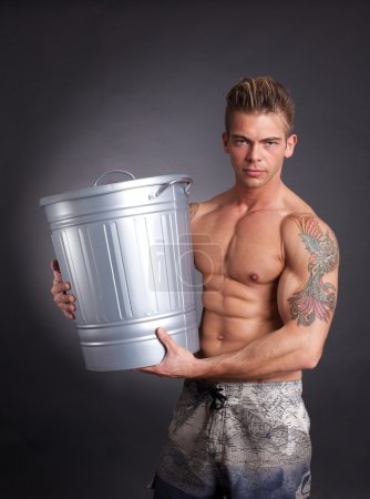 Muscular man with trash