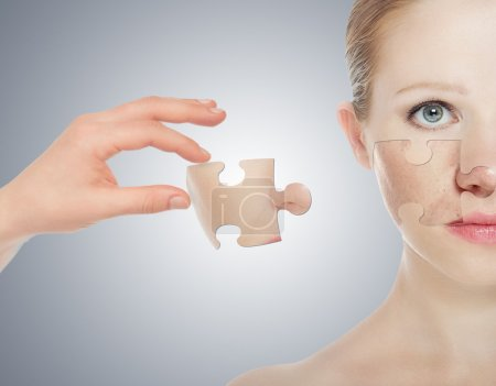 Concept skincare with puzzles. Skin of beauty young woman before