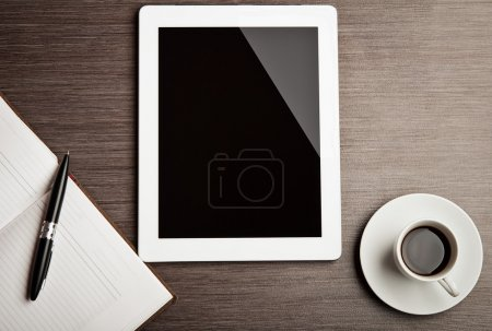Photo for Empty tablet and a cup of coffee on the desk - Royalty Free Image