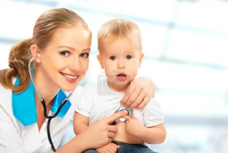 baby and doctor pediatrician. doctor listens to the heart with s