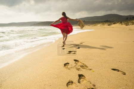 Photo for Beautiful happy woman running freely on the beach - Royalty Free Image