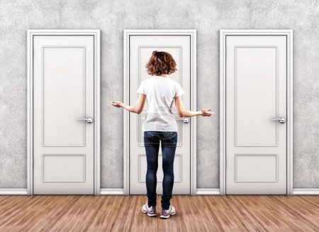 Photo for Girl before a white doors in fear of the unknown - Royalty Free Image