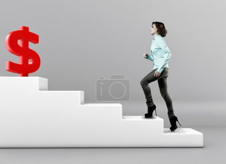 Photo for The girl rises upwards on a ladder to money - Royalty Free Image