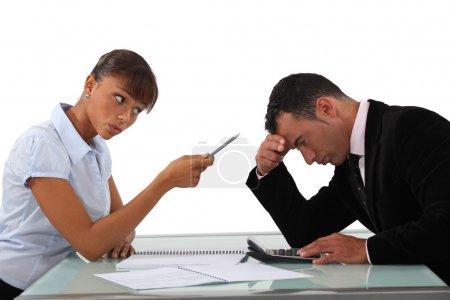 Woman scolding an ashamed man