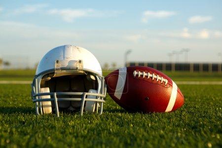 American Football and Helmet on the Field...