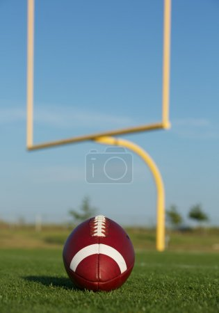 American Football with Goalposts Beyond