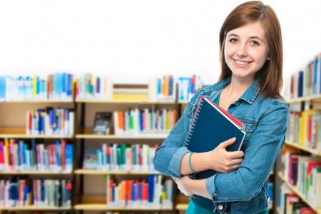 Photo for Portrait of a female college student at campus library - Royalty Free Image
