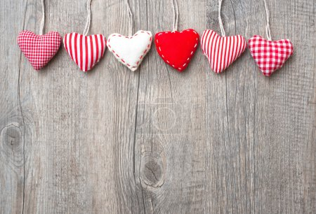 Photo for Red hearts hanging over grey wood background - Royalty Free Image