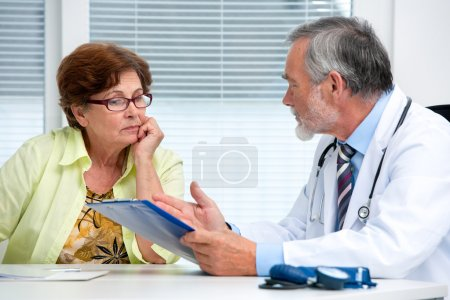 Doctor talking to his female patient