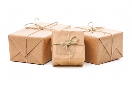 Photo for Group of parcels wrapped with brown paper and tied with string. Isolated on white background - Royalty Free Image