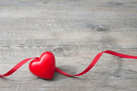 Photo for Heart with red ribbon on old wooden, Valentines Day background - Royalty Free Image