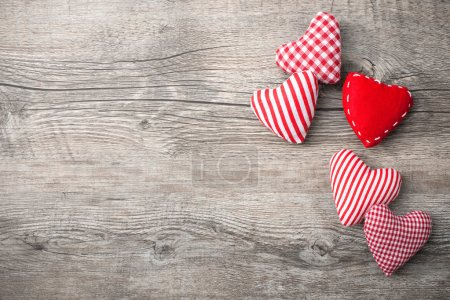 Photo for Valentines Day background with patterned textile hearts on old wooden - Royalty Free Image