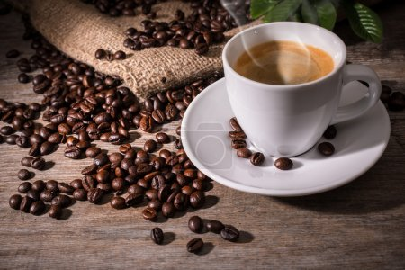 Photo for Cup of coffee and coffee beans on wooden background - Royalty Free Image