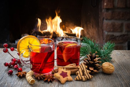 Photo for Delicious mulled wine with christmas decoration at romantic fireplace - Royalty Free Image