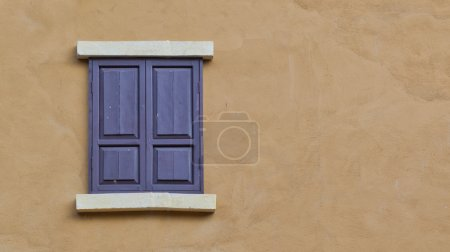 Wooden window on a house wall