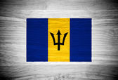 Barbados flag on wood texture