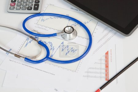 stethoscope with financial graph