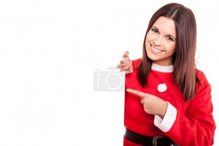 Christmas woman pointing to a white banner