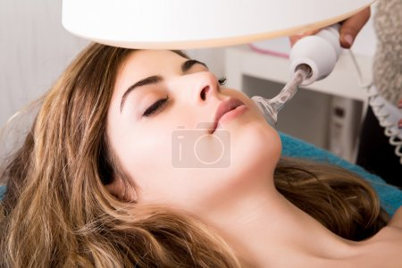 Woman doing cosmetic procedures