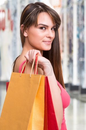 Photo for Happy latin woman holding shopping two bags - Royalty Free Image