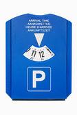 Modré parkovací disk na bílém pozadí
